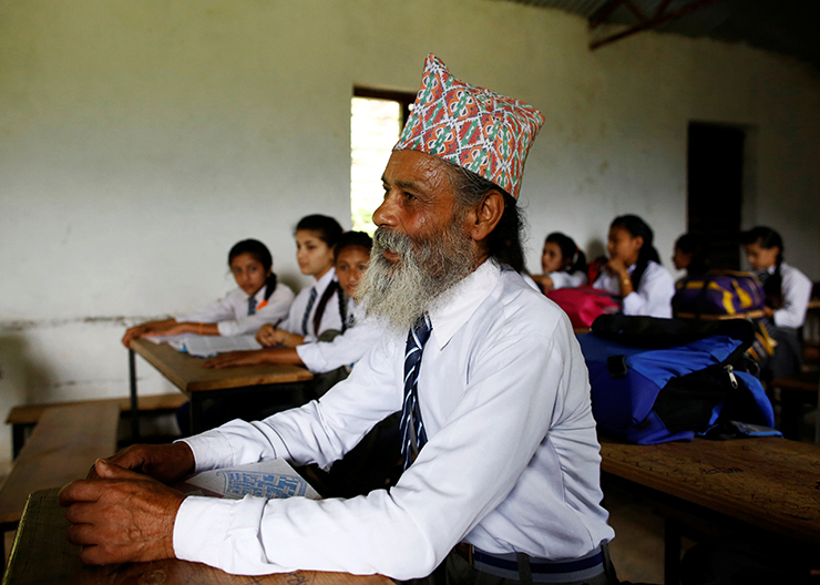 The Wider Image: Nepal's 68-year-old student